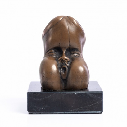 Erotic Sculpture of a Penis with a face.
