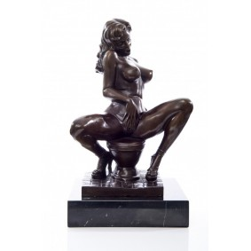 Bronze sculpture of a nude woman on toilet