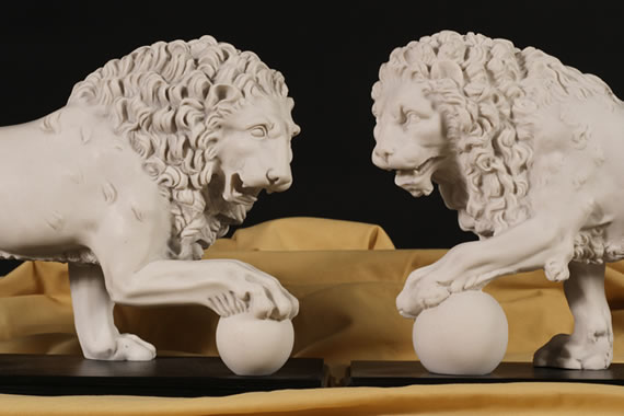 A Pair of Marble Lion Sculptures